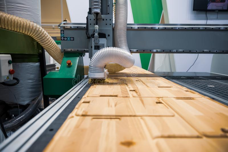 CNC woodworking wood processing machine, modern technology in the industry. CNC woodworking wood processing machine, modern technology industry royalty free stock photo