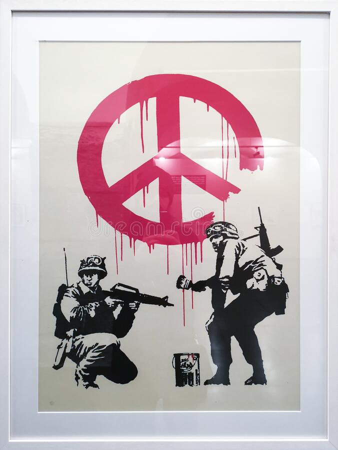 CND Soldiers, Banksy 2005. CND Soldiers, an artwork done by the anonymous English street graffiti artist Banksy in 2005. A silkscreen print on paper of two stock photography