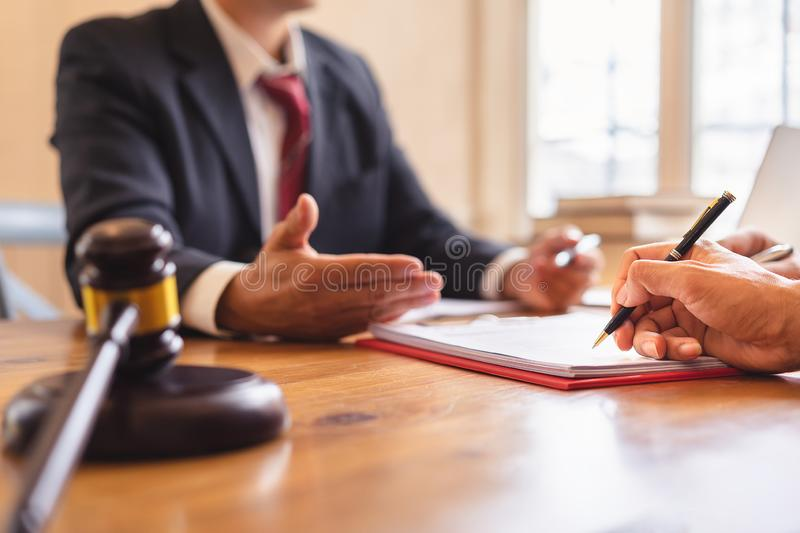 Co-investment business and lawyer or judge team signing contract agreement,. Concepts of law, advice, legal services stock photo