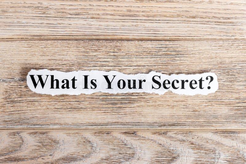 Co Jest Twój Tajnym tekstem na papierze Słowo Co Jest Twój sekretem na poszarpanym papierze com pojęcia figurki wizerunku odpoczy fotografia royalty free