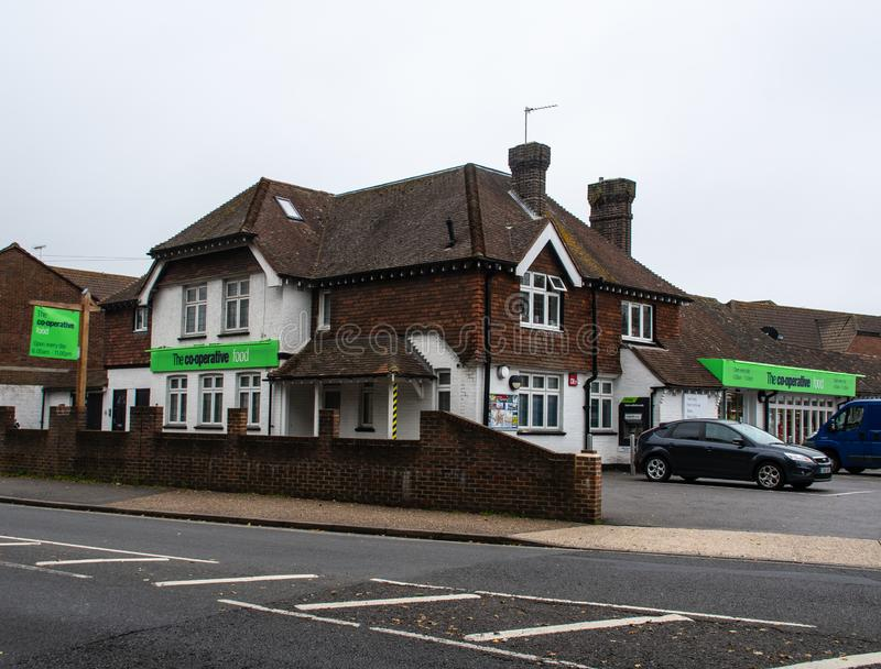 Co-op Supeermarket shop. Chichester, United Kingdom - October 06 2018: An Old house converted into a Co-Op Supermarket on Spitalfield Lane stock photos