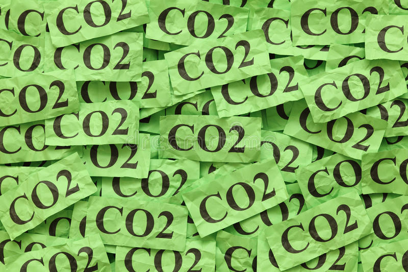 CO2. Pile of green paper notes with word CO2 (Carbon Dioxide royalty free stock image