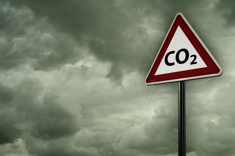 Co2 on roadsign. Under dark cloudy sky stock photo