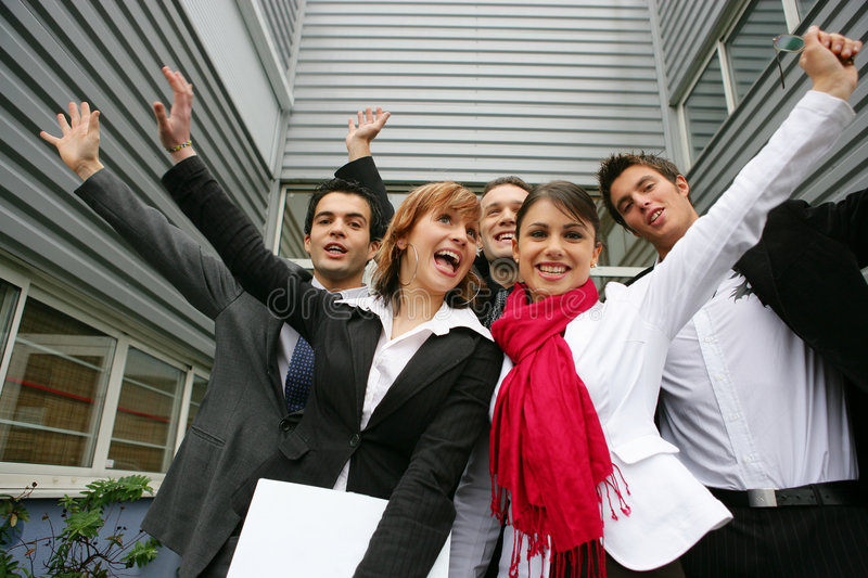 Co-workers celebrating outside stock images