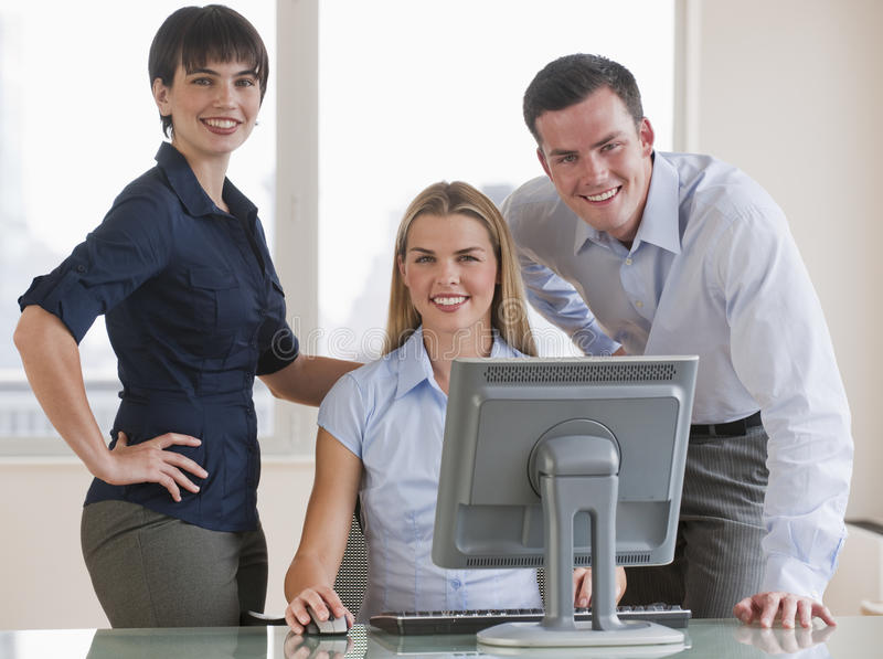 Co-Workers With Computer royalty free stock photos