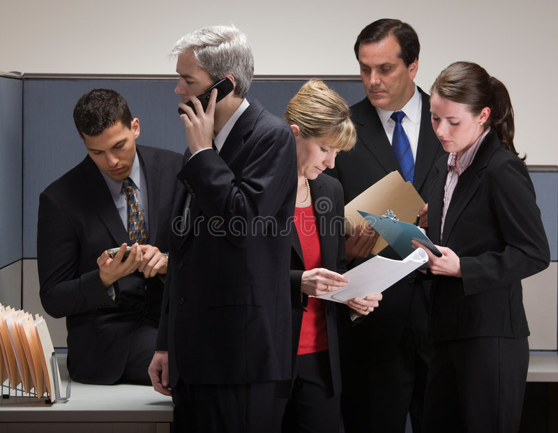 Co-workers in crisis meeting in cubicle royalty free stock images