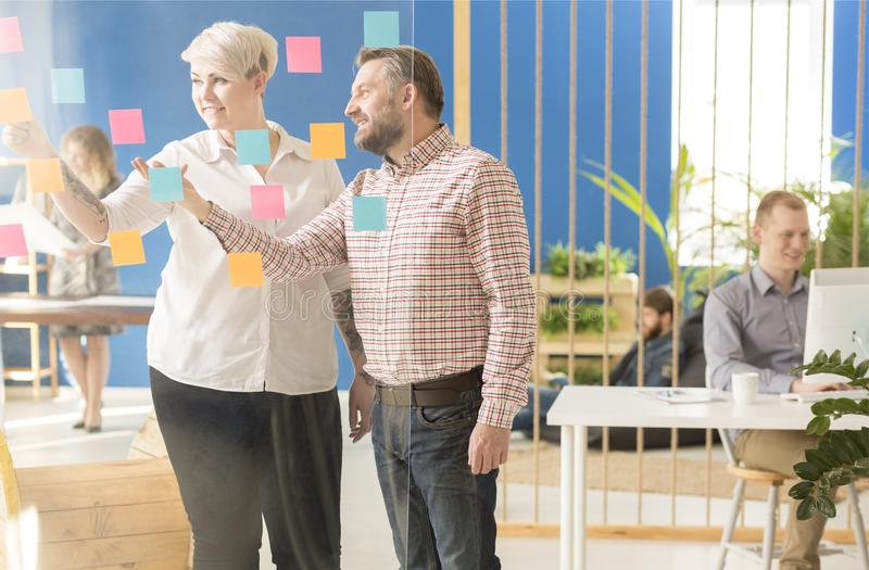 Co-workers talking about ideas. stock photography