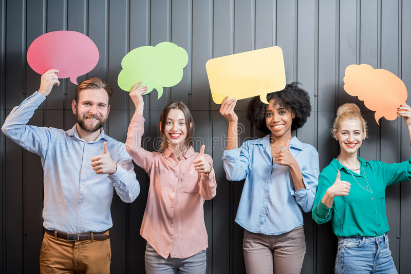Co-workers with thought bubbles royalty free stock image