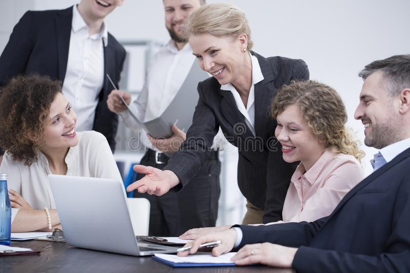 Co-workers working on project together stock photo