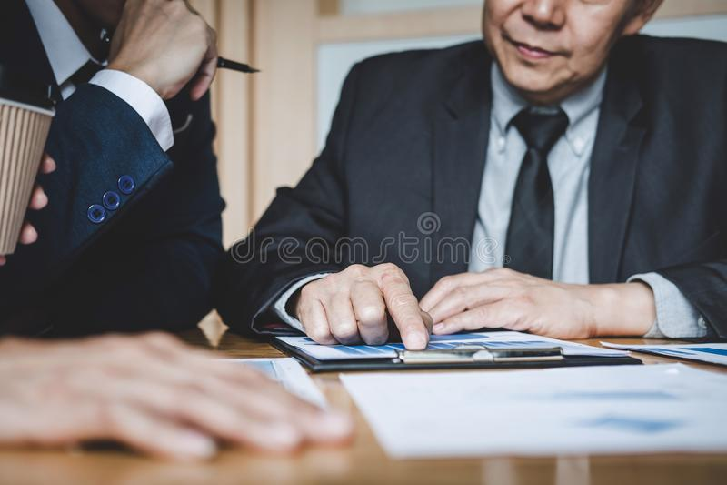 Co working conference, Business team colleagues discussing working analysis with financial data and marketing growth report graph. In team, Business finances stock image
