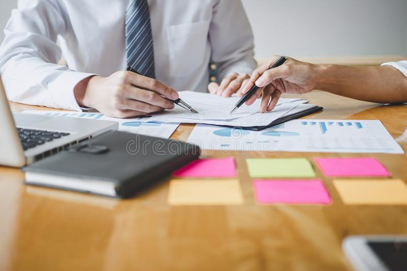 Co working conference, Business team colleagues discussing working analysis with financial data and marketing growth report graph royalty free stock photo