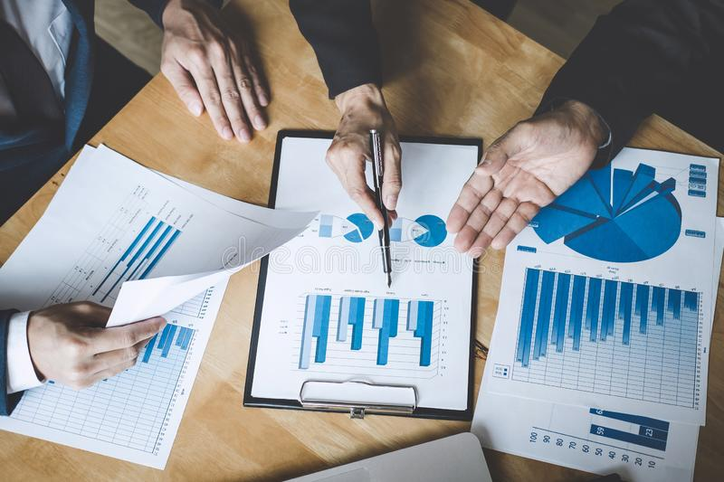 Co working conference, Business team colleagues discussing working analysis with financial data and marketing growth report graph. In team, Business finances royalty free stock image