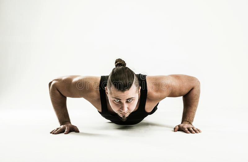 Coach bodybuilding performs push-UPS.photo on a white background. Coach bodybuilding performs push-UPS.the photo has a empty space for your text royalty free stock images