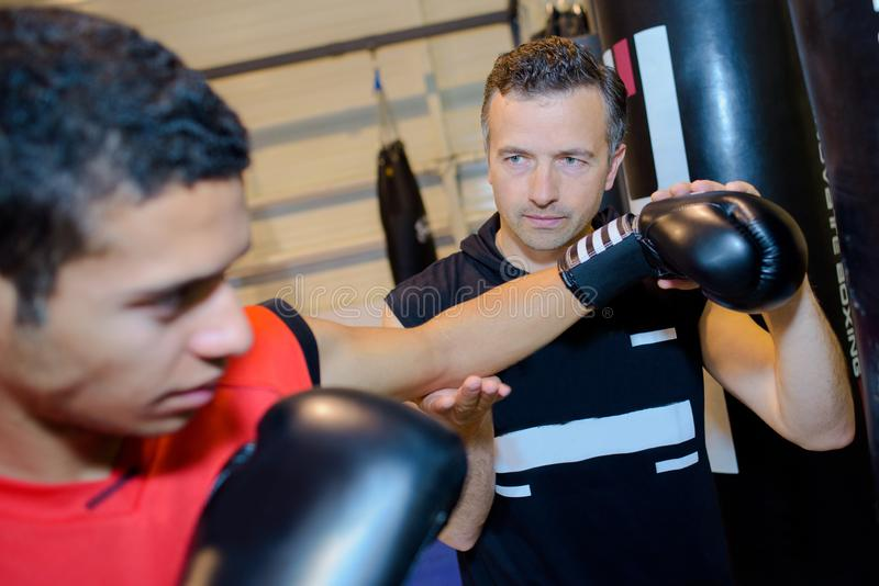 Coach and boxing student stock image