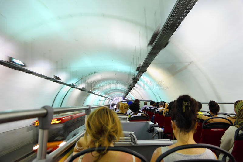 Coach Bus Rides In Tunnel Editorial Stock Photo
