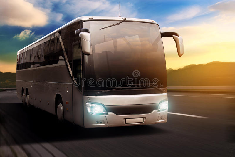 Coach. In front of a sunset background stock photography