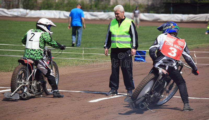 Coach looking at riders stock photography