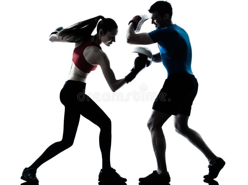 Coach man woman exercising boxe stock images
