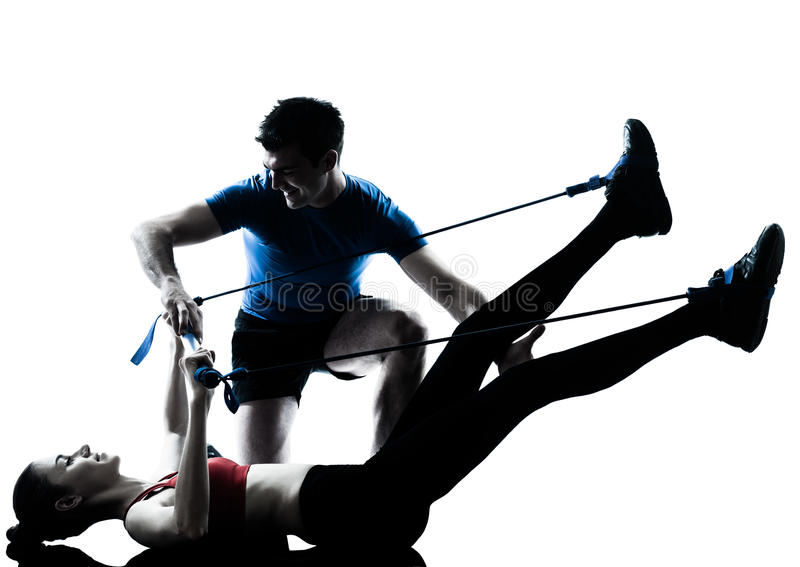 Coach man woman exercising gymstick royalty free stock photo