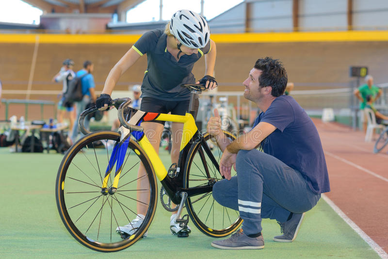 Coach supporting racing cyclist. Coach supporting a racing cyclist stock images