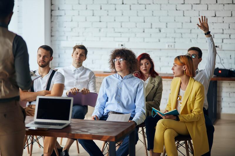 Young business man team leader coach mentor talk to diverse business people in modern office stock photos