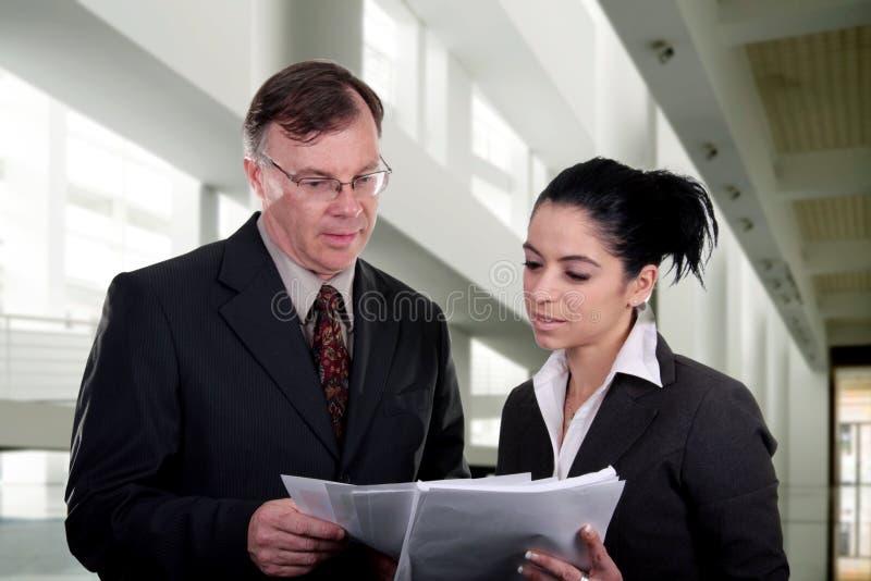 Coaching. Businessmen coaching a businesswomen at work