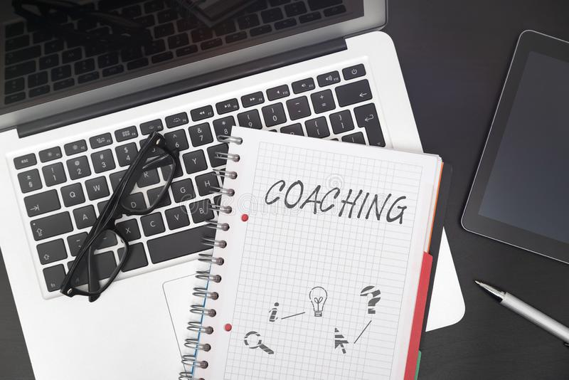 Coaching, business training concept at work. Coaching composition on desk. Business training concept at work stock photo
