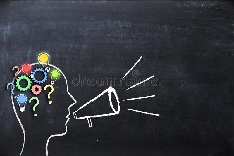 Coaching concept – knowledge and ideas sharing with human head shape and megaphone or bullhorn on blackboard. Coaching concept – knowledge sharing stock photos