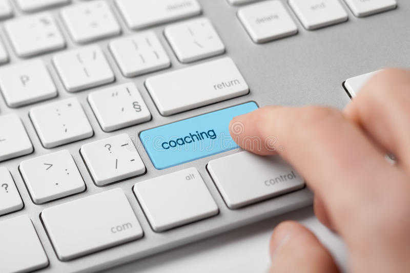 Coaching. Concept. Man looking for a coach on-line