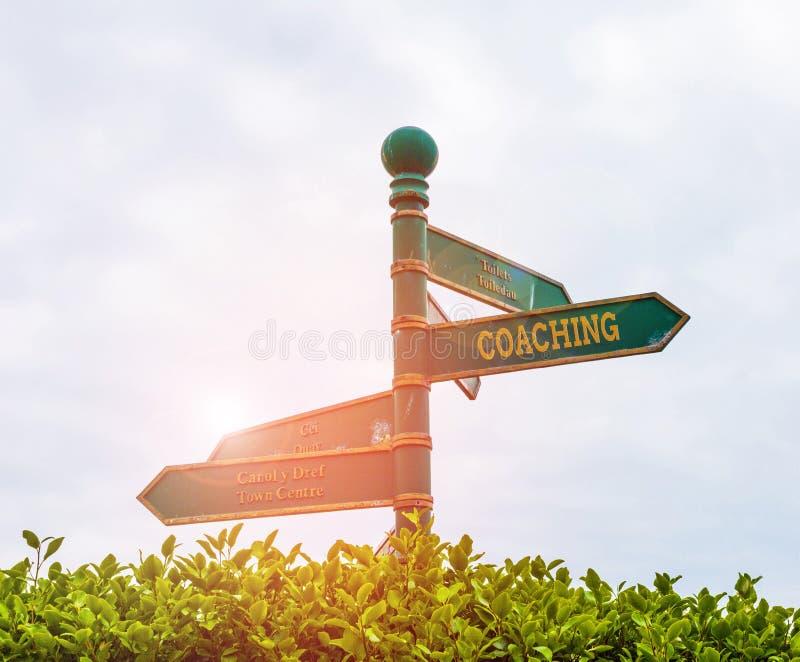 Coaching för handskriftstext Begrepp som att visa stöd för klienten när det gäller att uppnå specifika demonstrationsmål arkivbilder