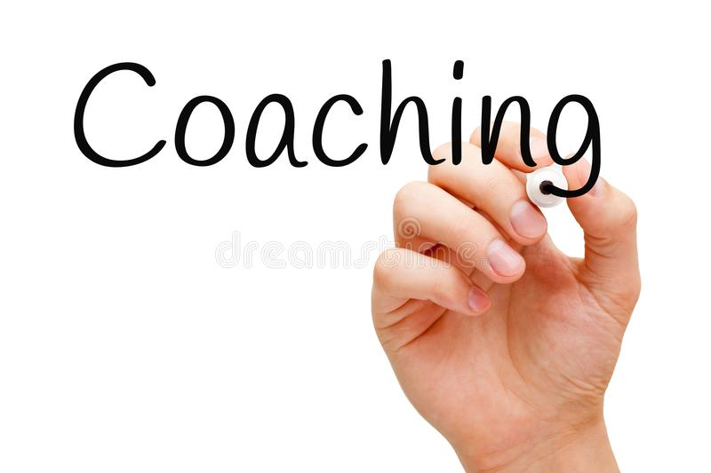 Coaching Handwritten With Black Marker. Hand writing Coaching with black marker on transparent wipe board royalty free stock image