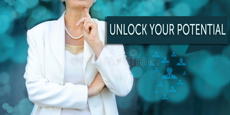 Coaching and human development concept. leader businesswoman, m. Anager stands next to the banner with text UNLOCK YOUR POTENTIAL royalty free stock photography