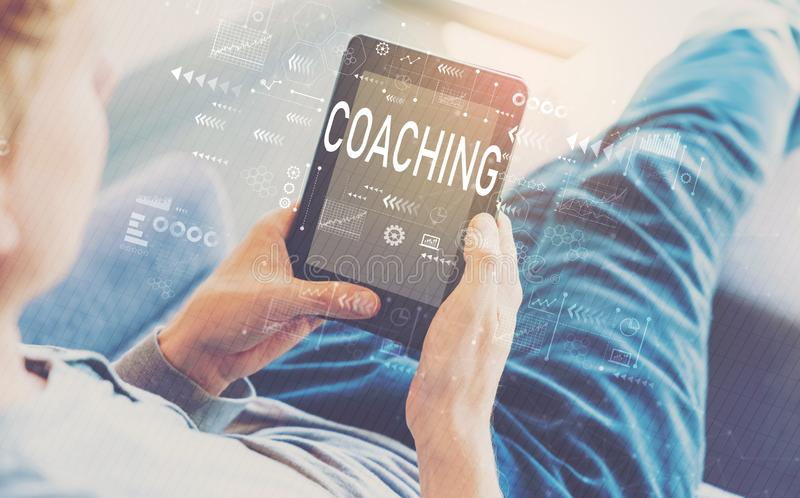 Coaching with man using a tablet stock photos