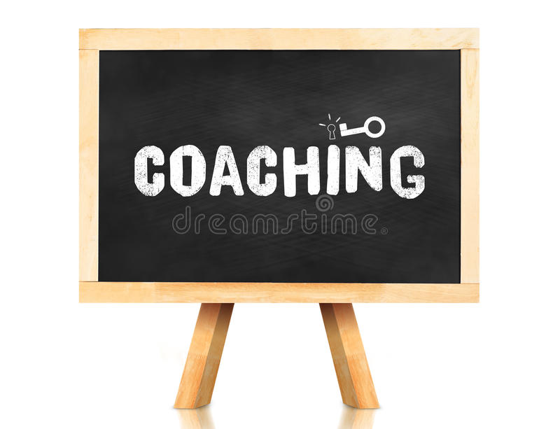 coaching word and key icon on blackboard with easel and reflection on white background,Business concept royalty free stock photography