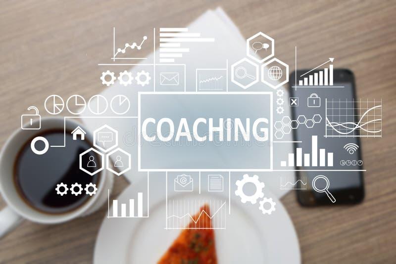 Coachning i affärsidé arkivbild