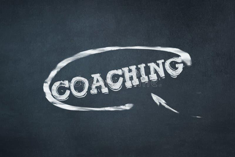 Coachning inskrift i krita p arkivbilder