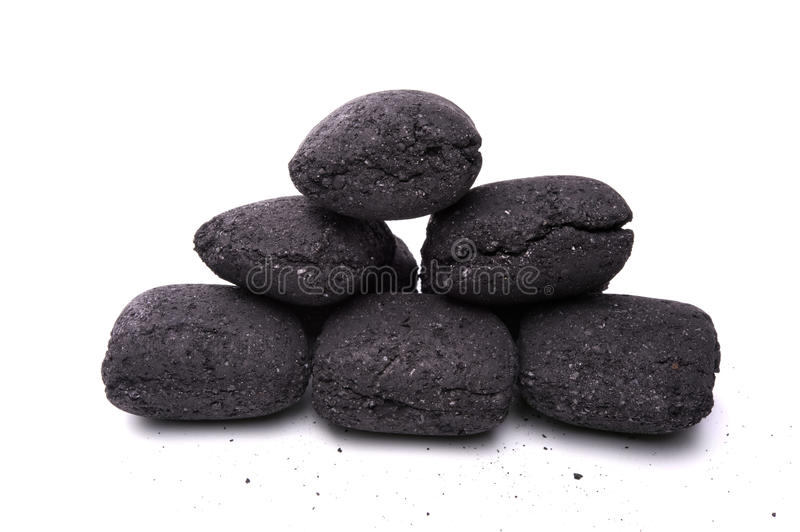Coal briquette for BBQ. Heap of coal briquette for BBQ isolated on white stock images