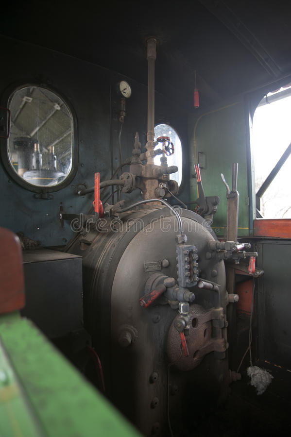 Coal engine in an old locomotive. Photo of Coal engine in an old locomotive royalty free stock photos