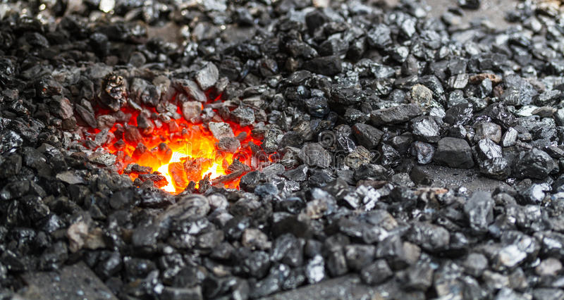 Coal and fire of a blacksmith's smithy stock photography