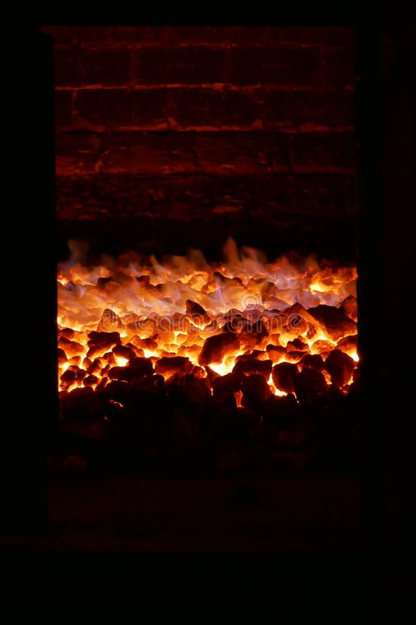 Coal fire in a brick kiln. Showing the heat of the kiln with the glow of the fire reflected in the roof of the kiln royalty free stock photo