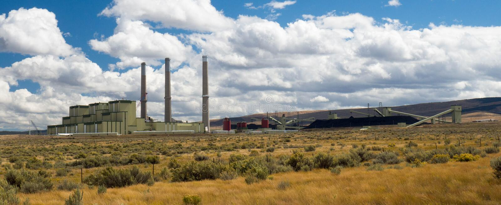Coal Fired Power Plant with Coal Stockpiles royalty free stock photos