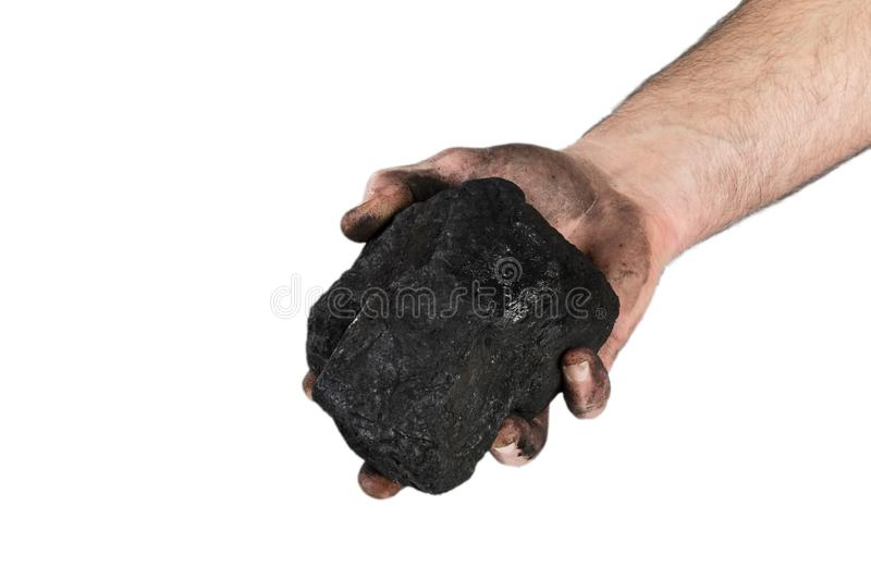 Coal in hand on a white background ,Coal mining: coal miner in hand royalty free stock image