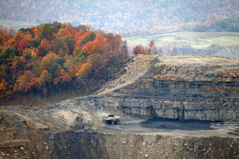 A coal mine, Appalachia, America. View of a coal mine with dumper truck surrounded by trees in autumn color royalty free stock photo