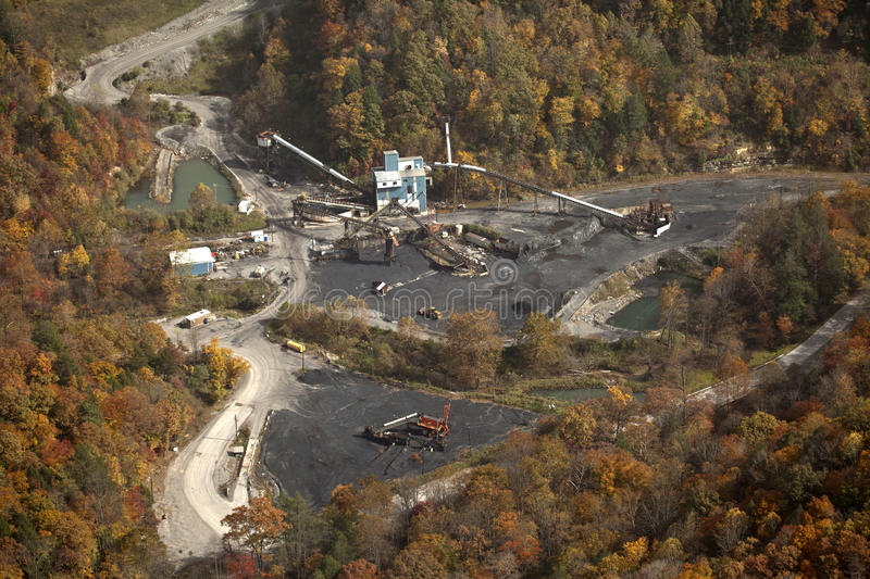 A coal mine, Appalachia, America. View of a coal mine in Appalachia, America. The mine is surrounded by forest in autumn color royalty free stock images