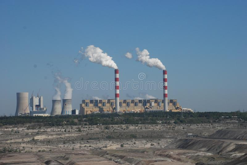 Coal mine in Belchatow Poland. From observation deck. smoking chimneys opencast mine stock photography