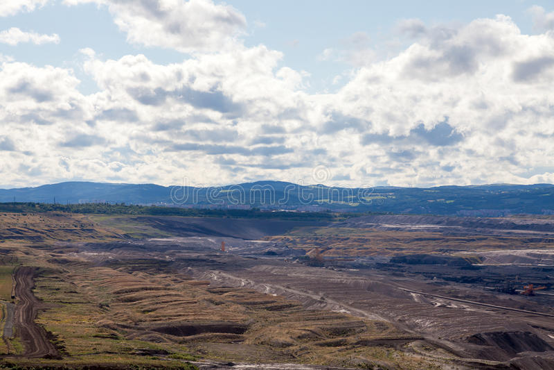 Coal mine, Most, Czech Republic. Cloudy sky royalty free stock photo