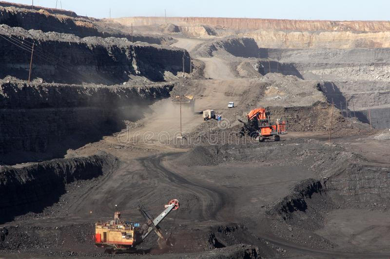 Opencast coal mining in a modern quarry royalty free stock images