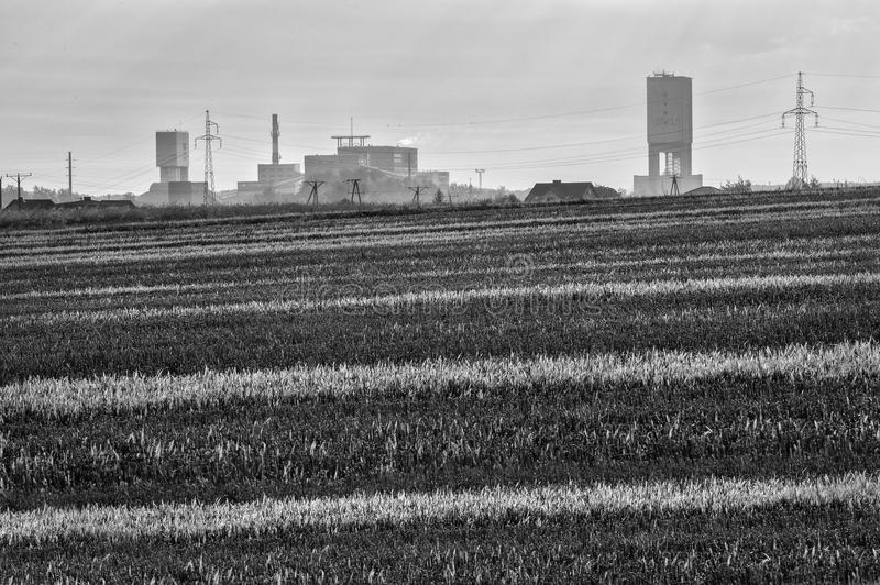 Coal mine and fields. Coal mine sun emition nature environment fields royalty free stock photos