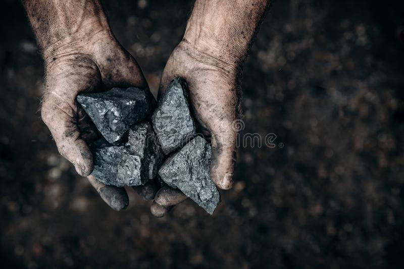 Coal in miner holds. Concept industry mining royalty free stock photography