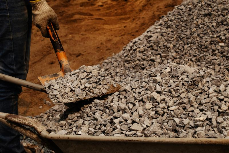 Coal mining - Man hand holding shovel and gravel black rock for background. Picture idea about coal mining, coal processing, energ. Y source, environment stock photo